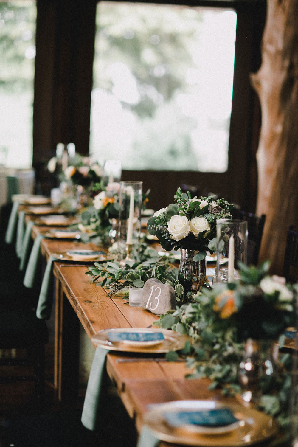Large greenery garland on wood head table