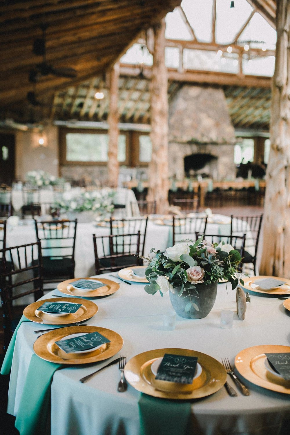 Organic wedding at brooks at weatherford wedding reception with ivory tablecloths and sage green napkins