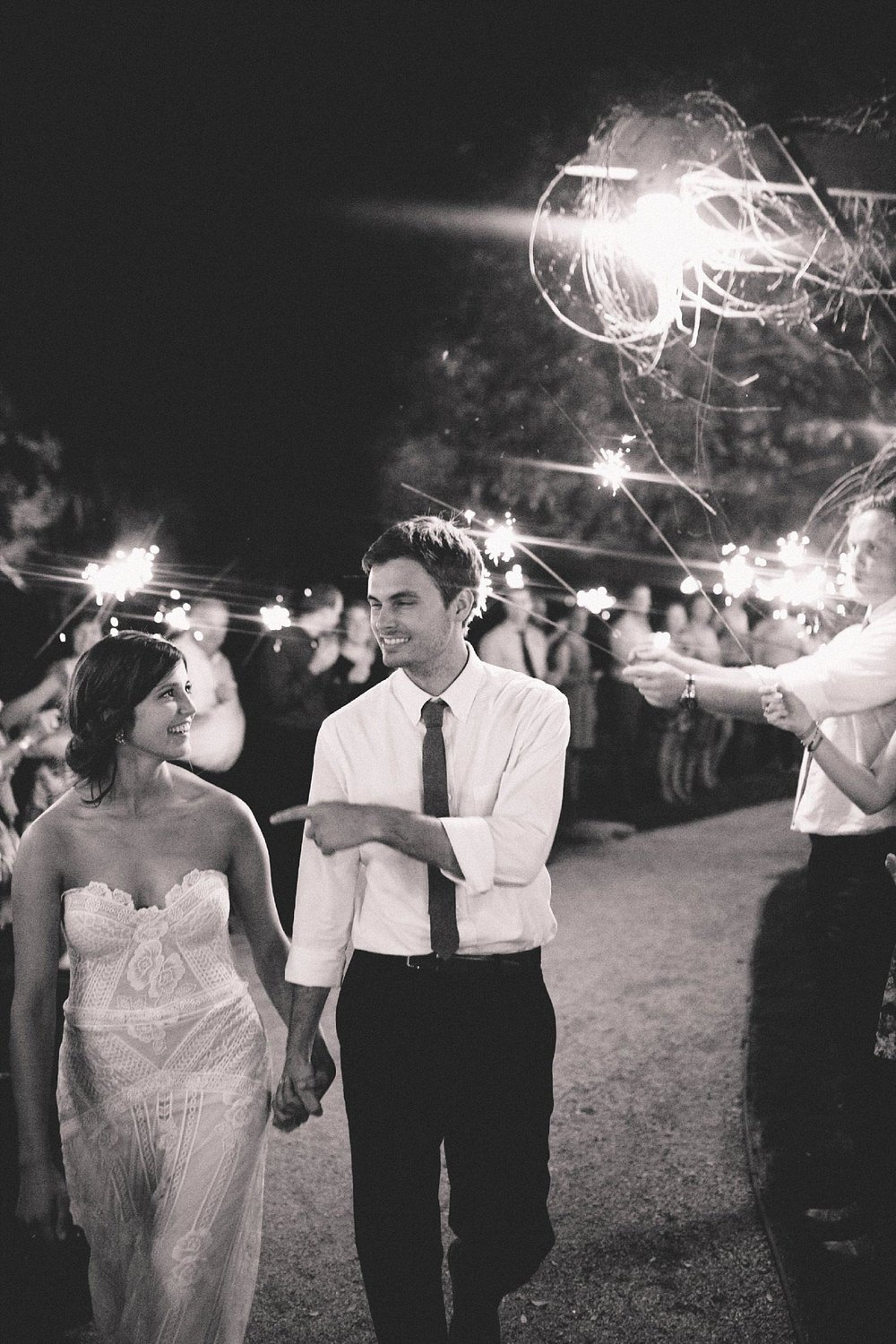 black and white picture of bride and groom exiting with sparklers