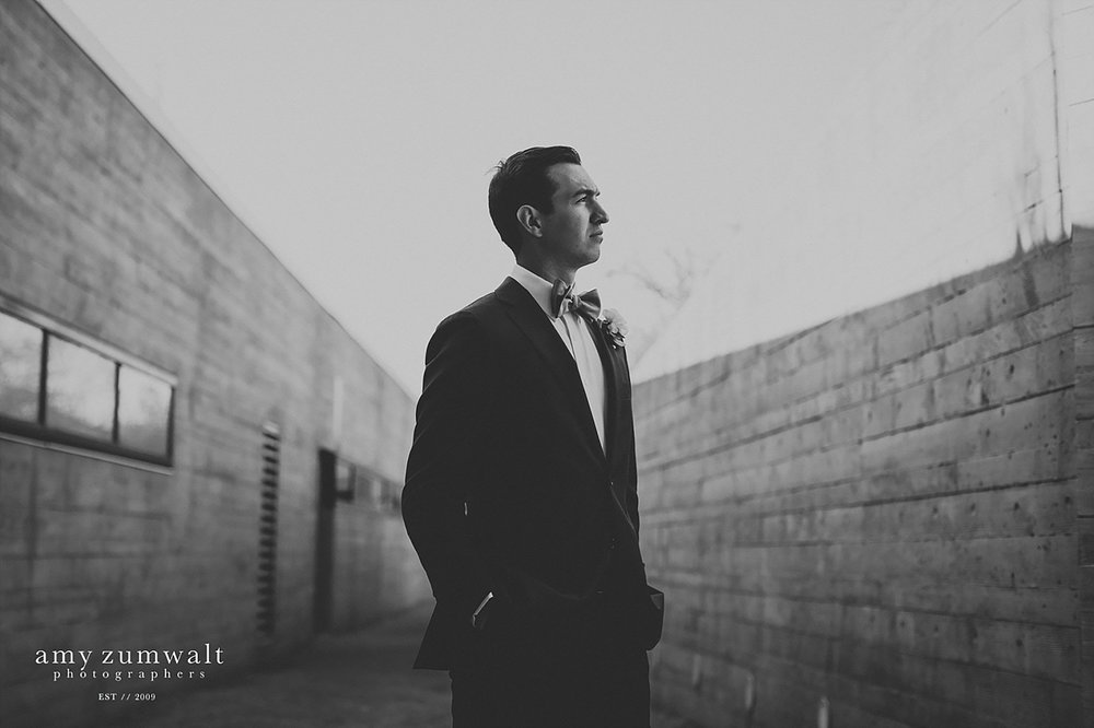 black and white photo of a groom