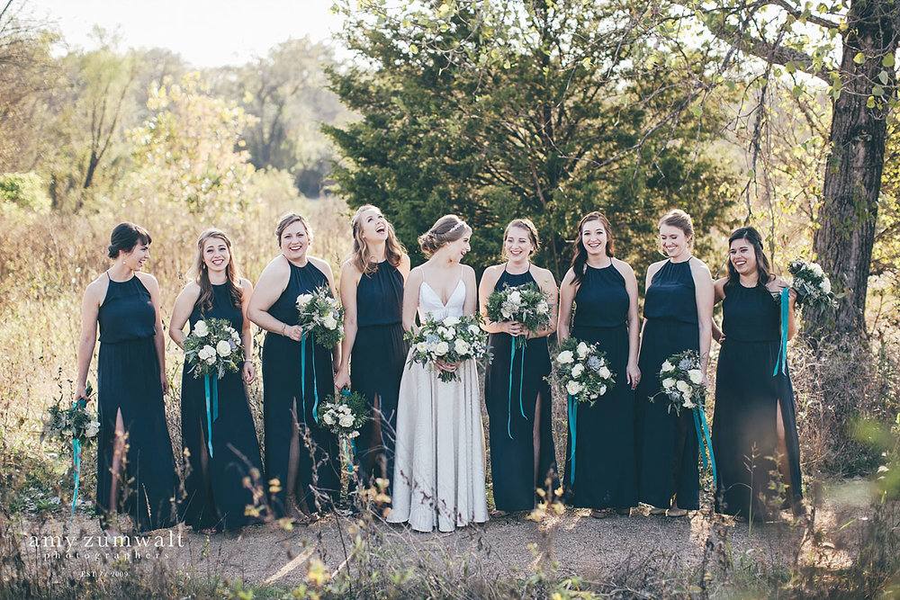 Bridesmaids in navy blue dresses at Trinity River Audubon Center in Dallas TX