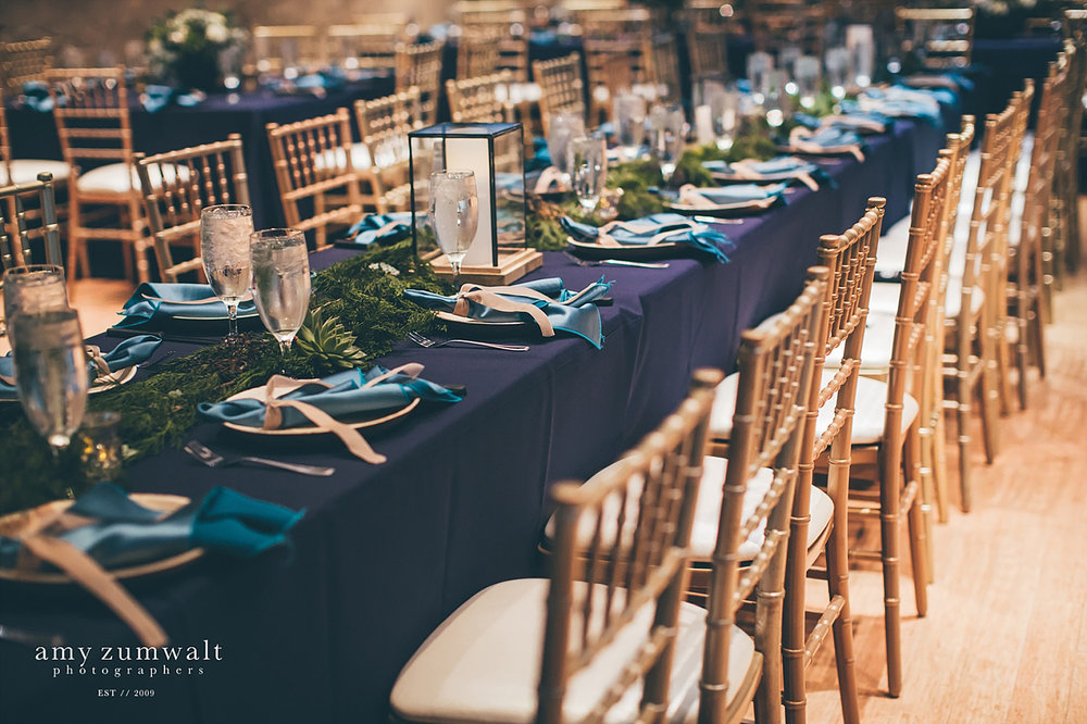 Head table with long evergreen garland