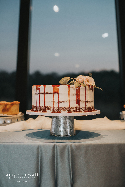 Caramel drip cake with a glavanized metal cake stand