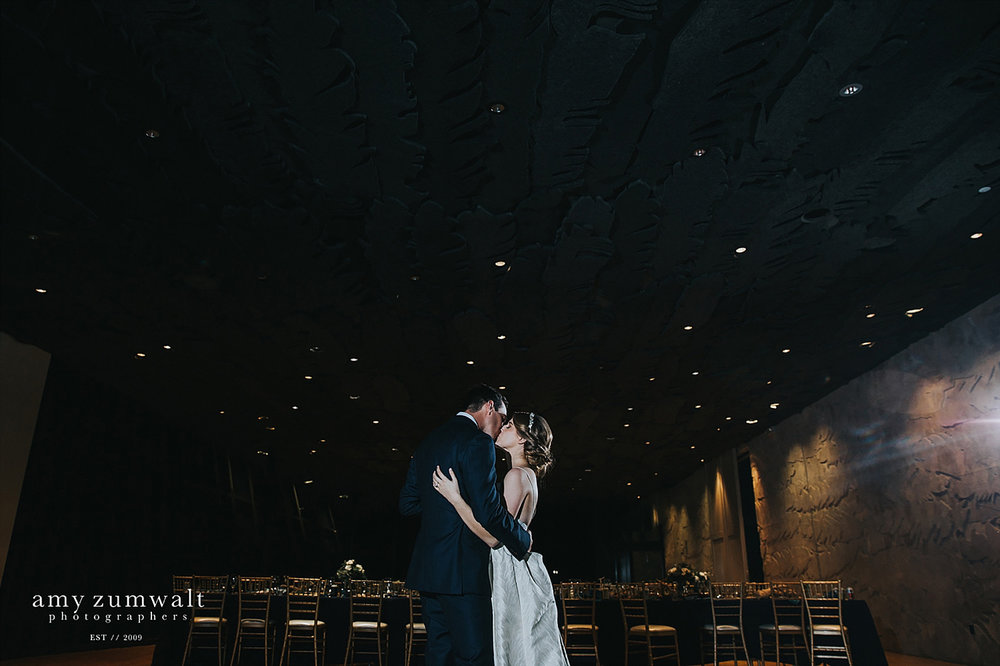 Bride and groom dancing at the Trinity River Audubon Center great room