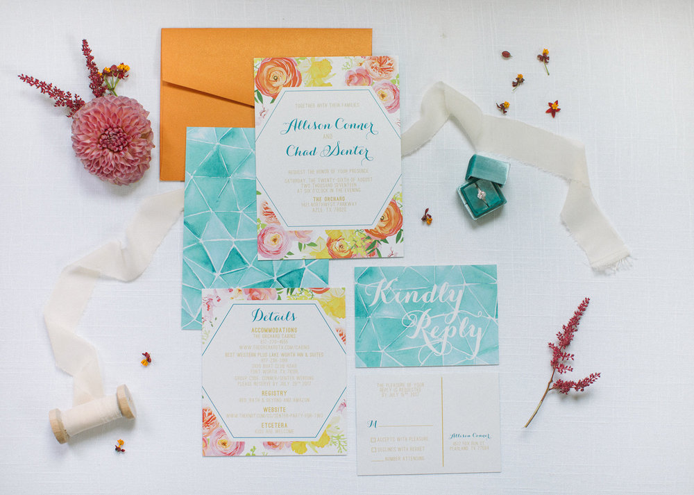 Colorful teal and orange wedding invitation with geometric shapes