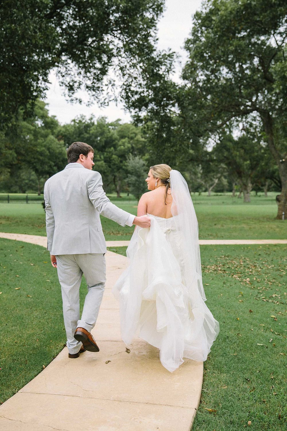 Bride and groom walking away from the ceremony at the Orchard in Azle TX