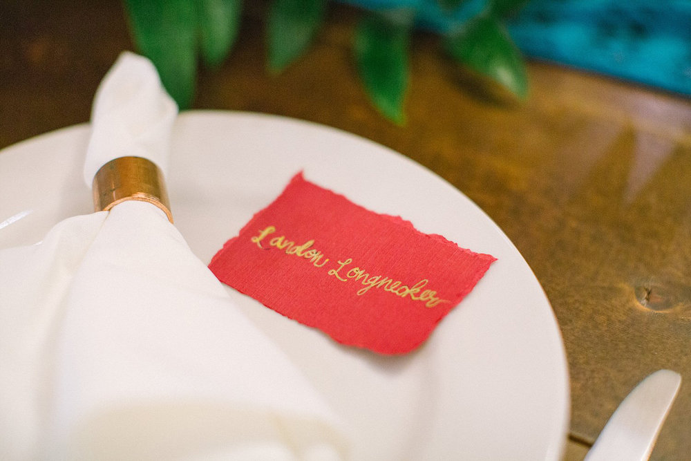 red escort card with torn edges