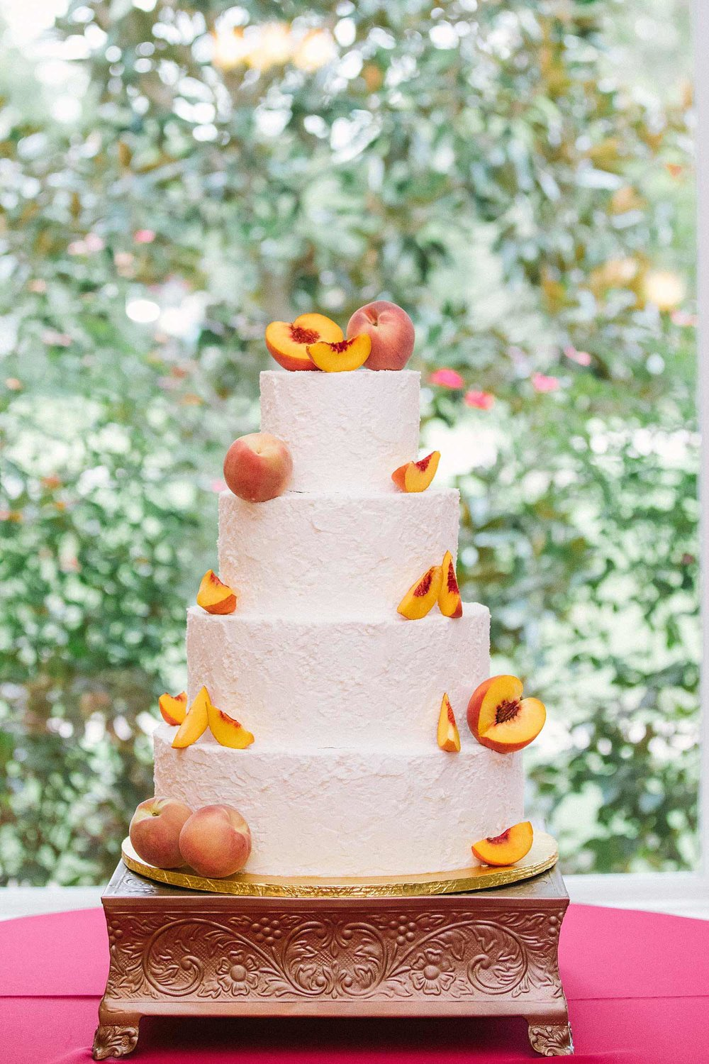 Wedding cake with peaches on copper cake stand