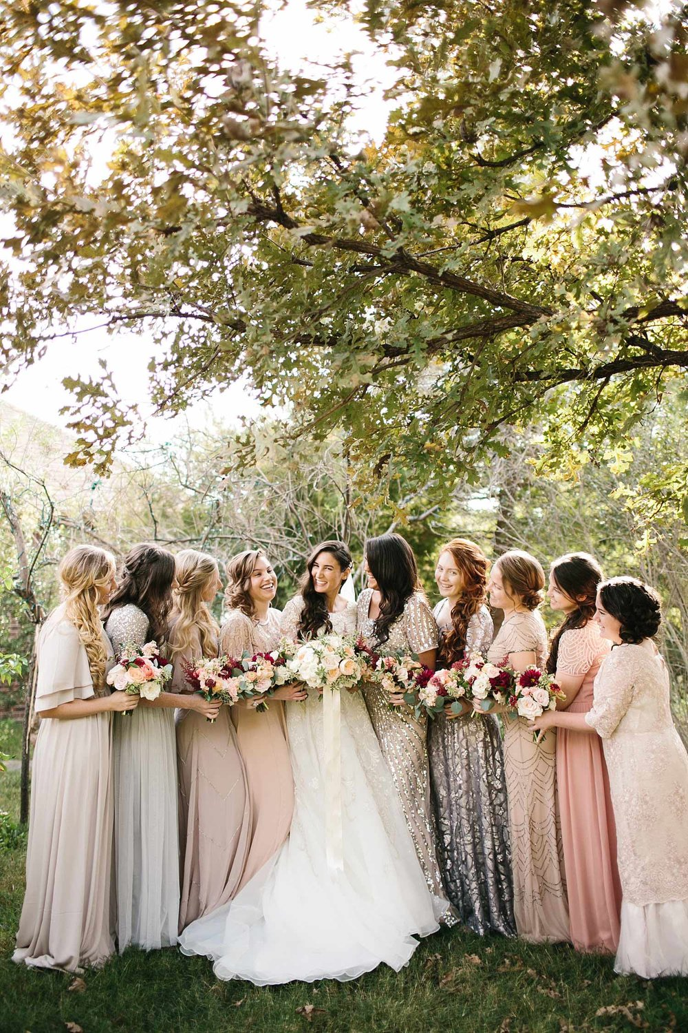 Bridesmaids in sequin blush dresses outside