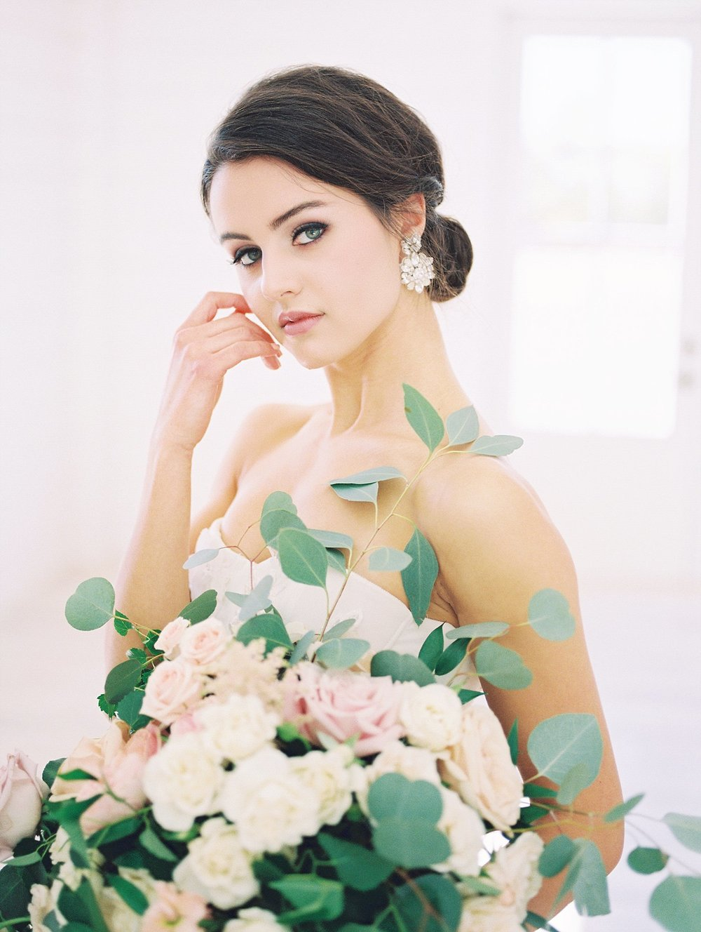 Bride with southern updo holding organic bouquet