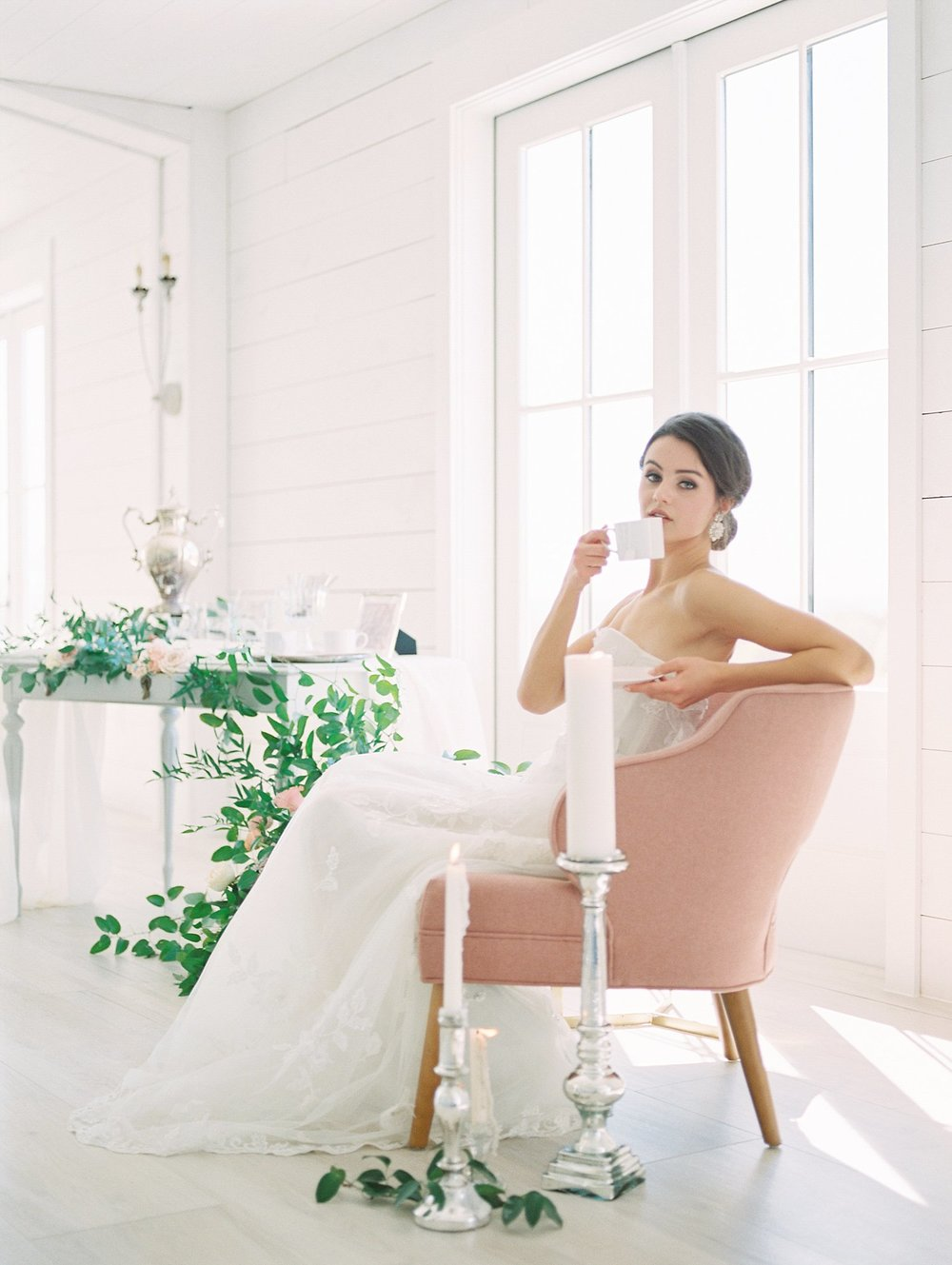 bride sitting in a pink chair drinking tea