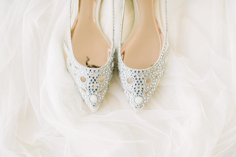 Silver wedding shoes on a white fabric