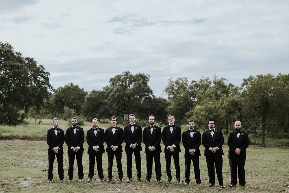 groomsmen in austin wearing black tuxes