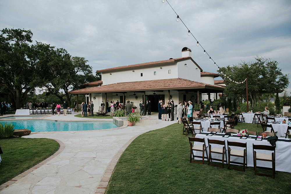 Outdoor reception in austin texas around a pool