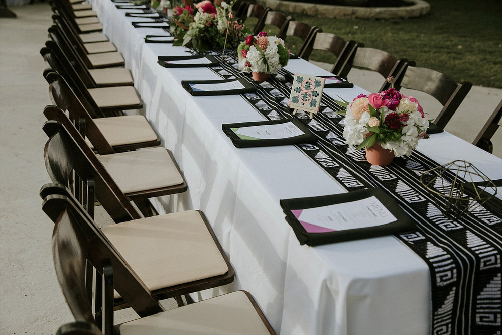 Modern mexicana head table with a black and white mexican pattern runner