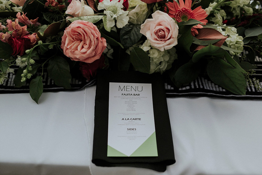 colorful geometric menu on a black napkin