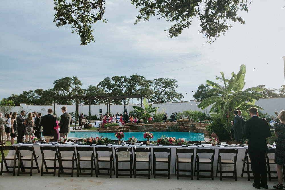 head table in front of a pool