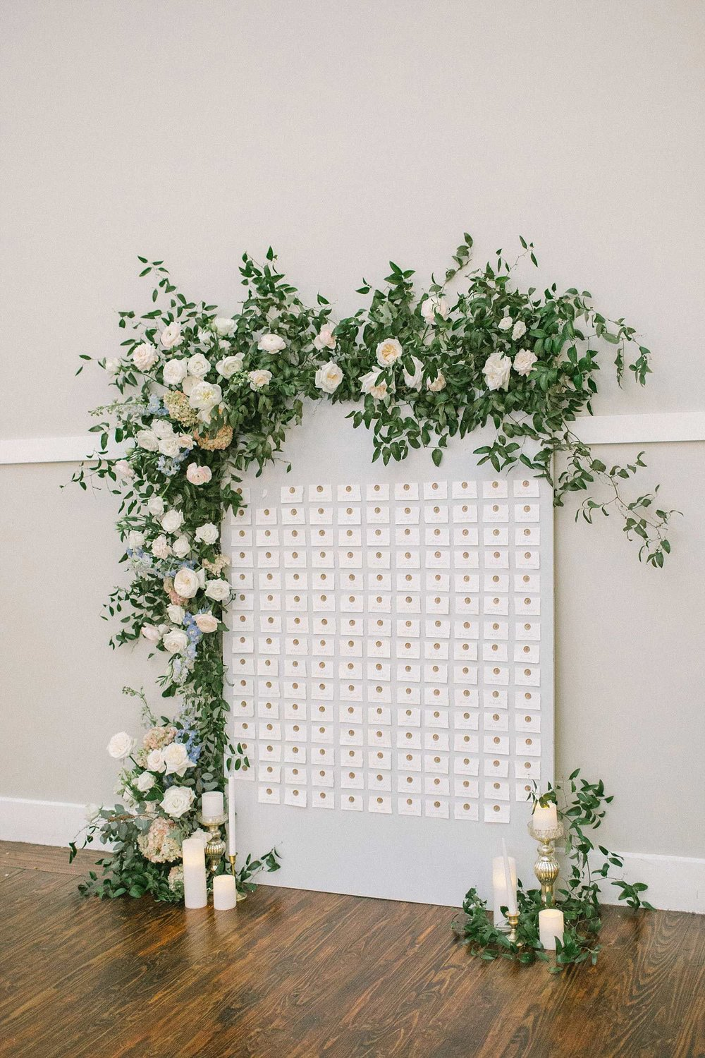 Grey wax seal seating chart with organic flowers