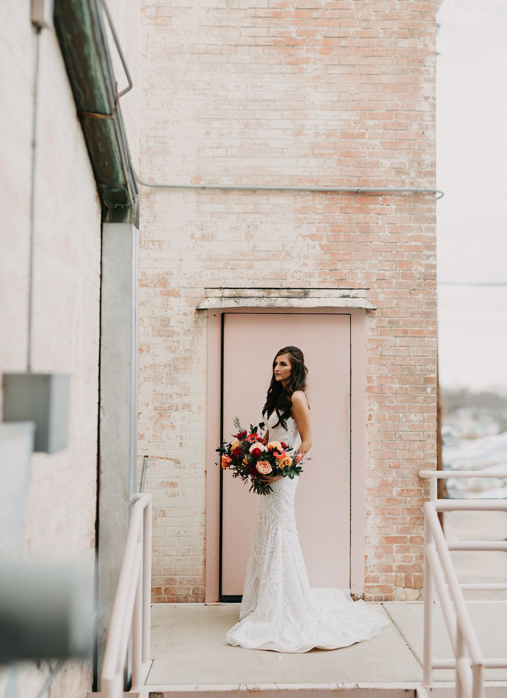 Bridals in front of a pink brick wall
