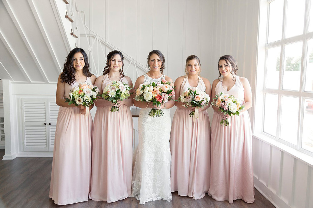 Blush bridesmaid dress with peach and pink bouquets