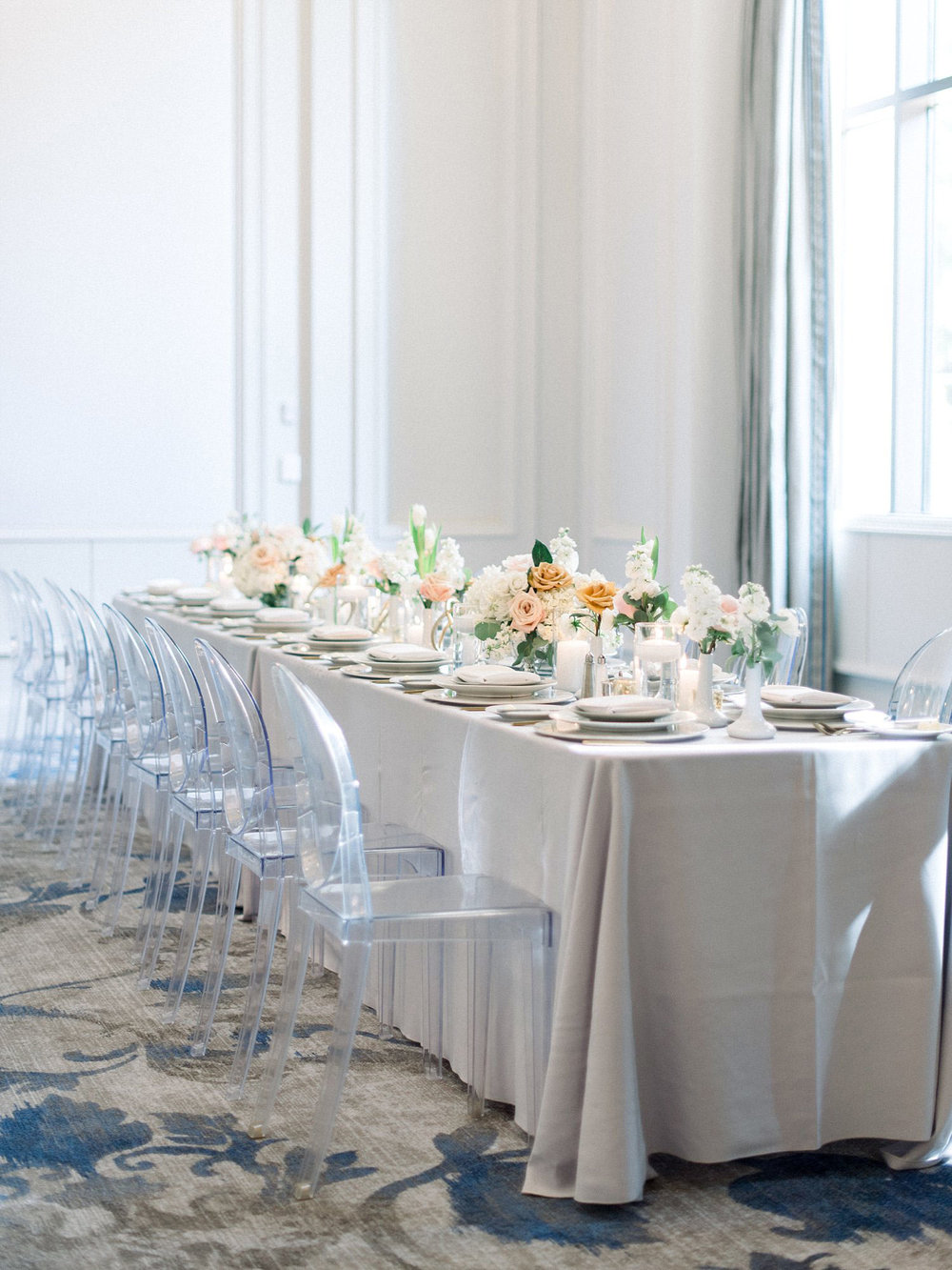 Ballroom wedding with Acrylic Chairs with a light grey linen