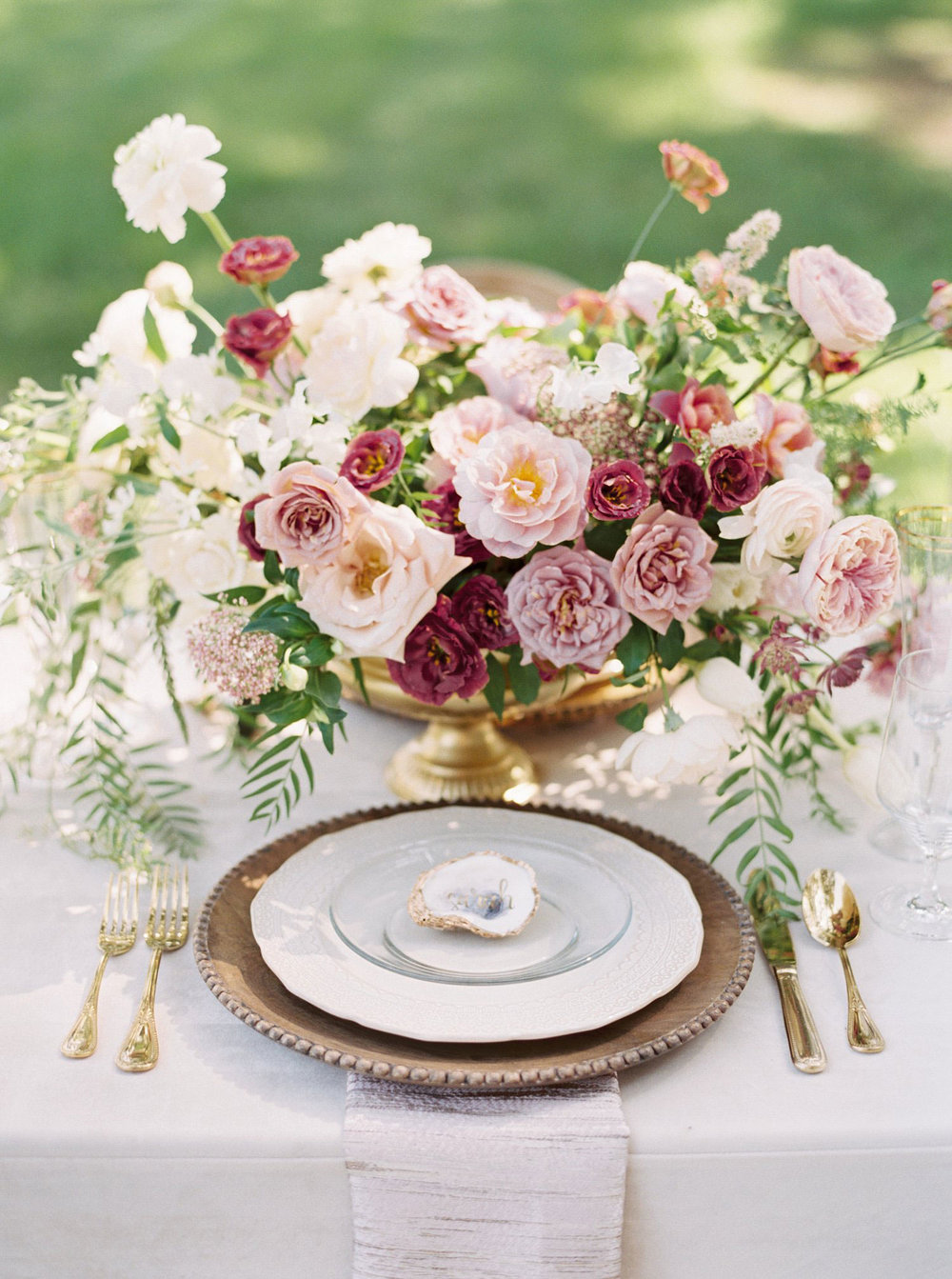 Southern Place setting with a wood charger and mauve flowers