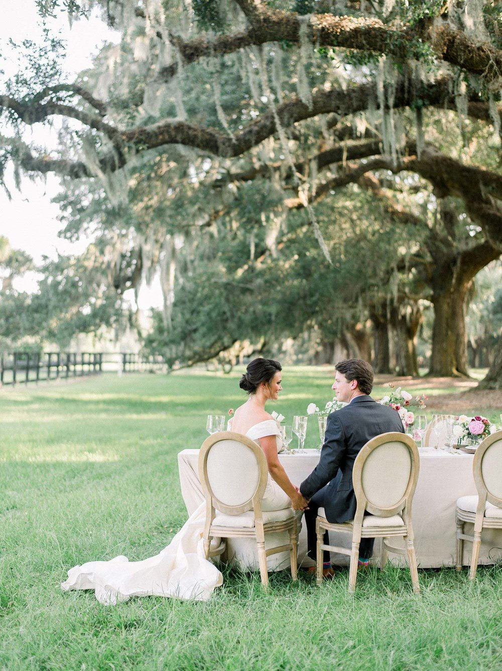 Bride and groom toasting in a Southern Wedding