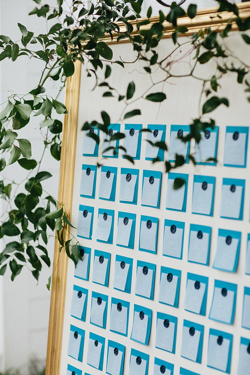 Navy wax seals and vellum paper seating chart