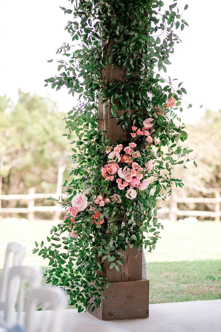 flower installation around wood post