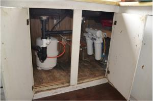 The water treatment systems (reverse osmosis units) are installed beneath each resident's sink, providing clean water for drinking and cooking through an additional spigot