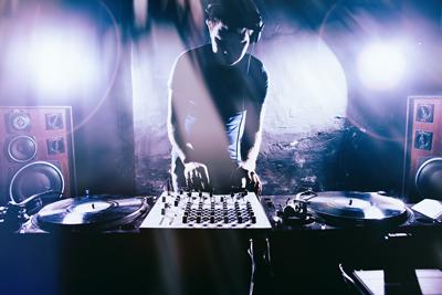 bigstock-Club-DJ-playing-mixing-music-o-168011111.jpg