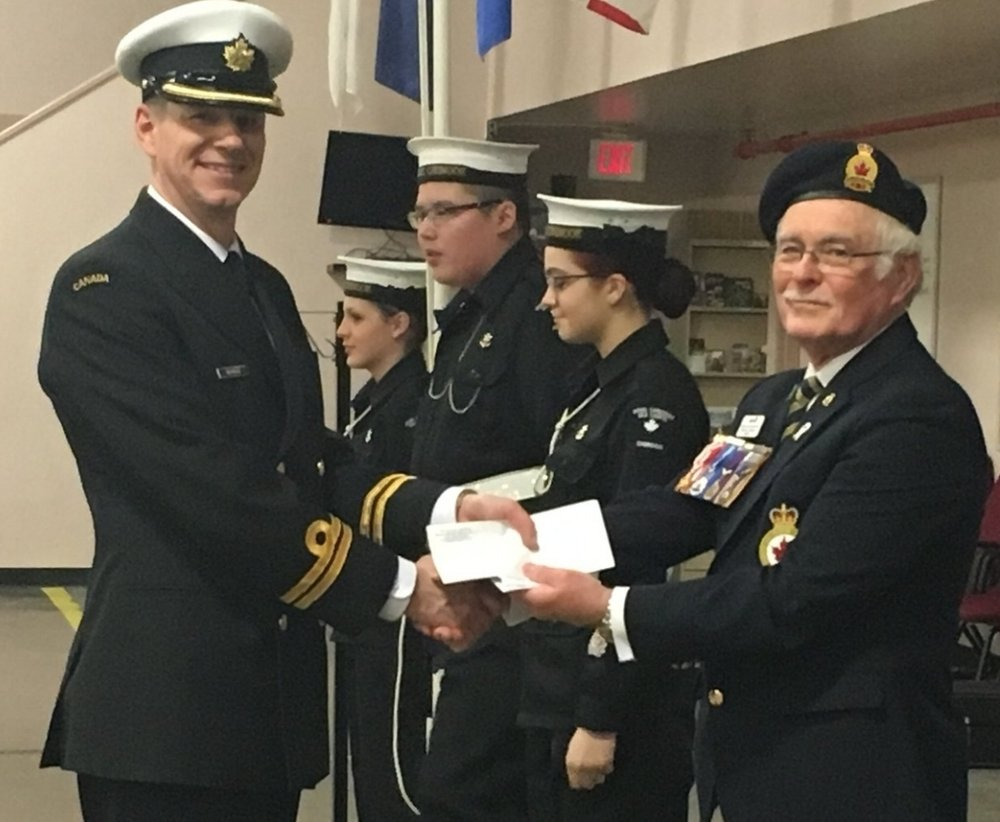 #50 Navy League Cadet Corp - Michael Cormican, President of the General Stewart Branch #4 presents a cheque to Commanding Officer Ian Mason in appreciation of their assistance to the Poppy Campaign.