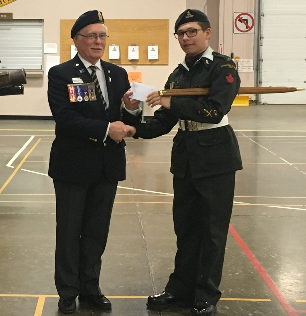 #2296 Royal Canadian Army Cadet Corp - President Michael Cormican presents a cheque to Warrant Officer Tyler Moch in appreciation of the Corps assistance to the Poppy Campaign. WO Moch is in his 5th year with the Army Cadets.