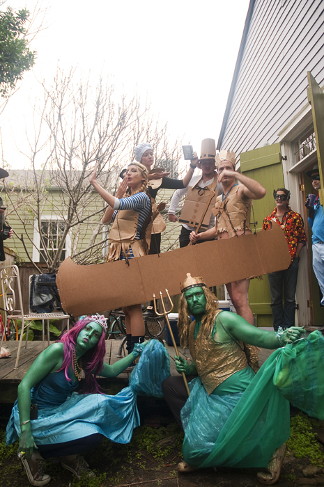 mermaid and merman with pilgrims