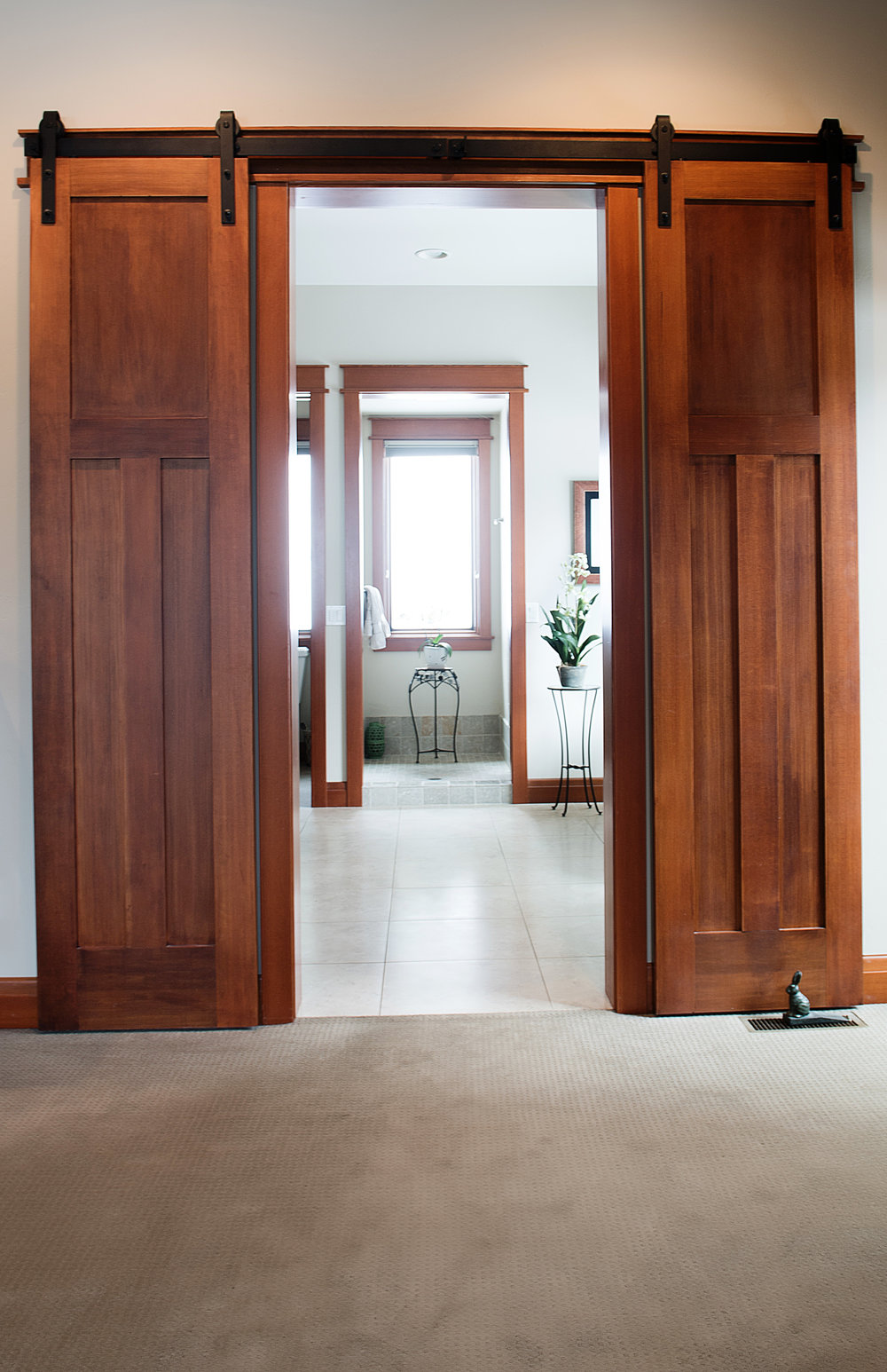 A detail shot of some rolling bathroom doors we created for a custom build in Big & Custom Doors   Bozeman Montana Builders   General Contractor ...
