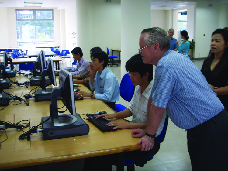 Chuck Feeney with a student at Hue University's Learning Resource Center in Viet Nam.Photo: Le Nhan Phuong