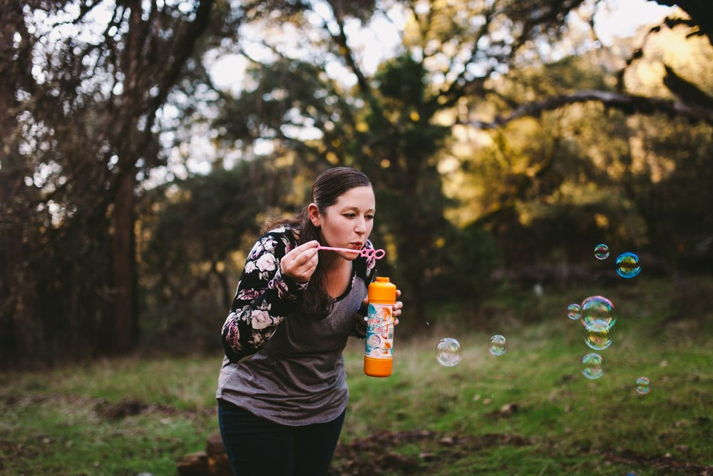 Mom Blowing Bubbles in Family Photography Session in Northern California