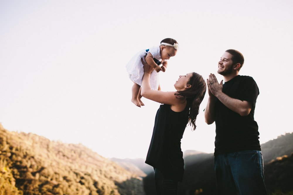 Happy Laughing Family Portrait Holding Toddler up in the Air Foothills of Sierra Nevada Mountains