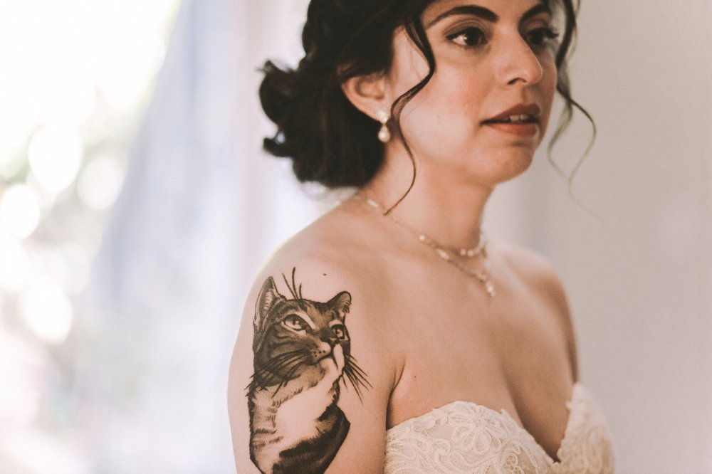 Bride with a Cat Tattoo on Shoulder