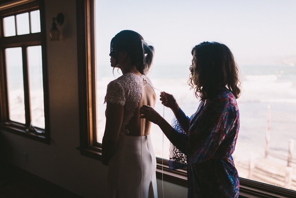 Bride Putting on Anais Anette Savannah Wedding Gown Dress