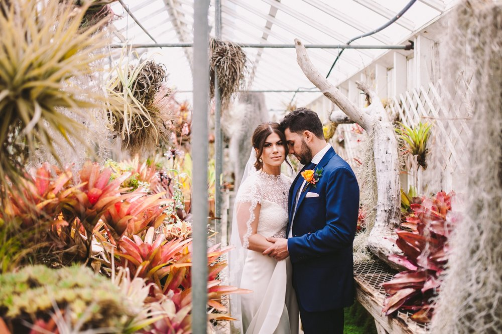 Bride & Groom Portrait in Shelldance Orchid Garden Greenhouse