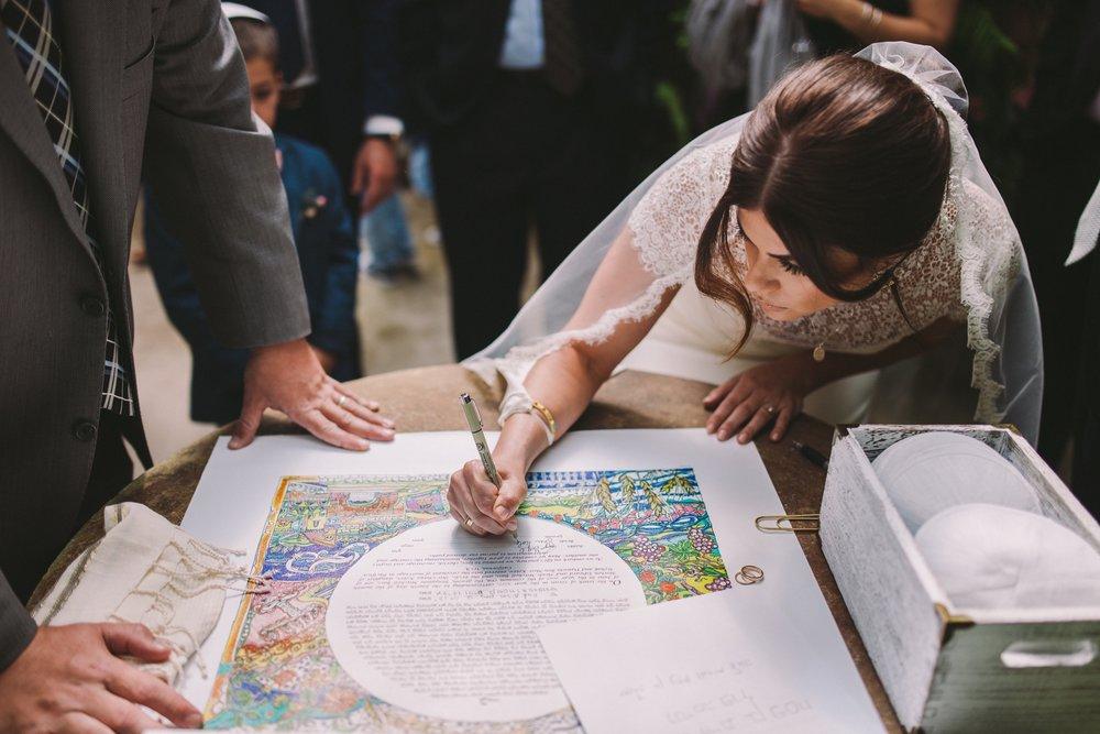 Bride Signing the Ketubah Shelldance Orchid Gardens