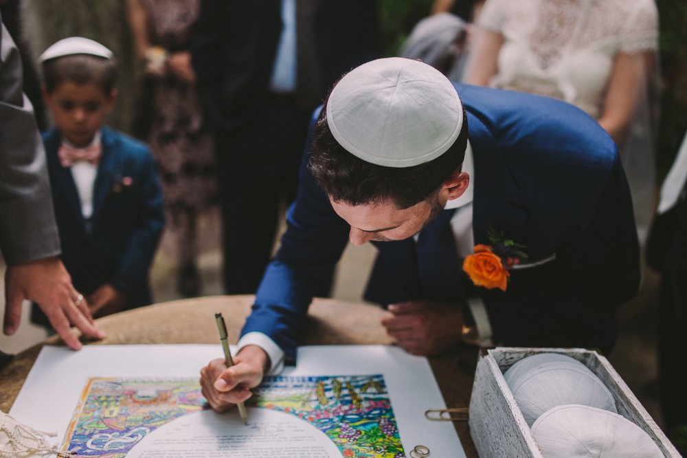 Groom Signing the Ketubah at Shelldance Orchid Gardens Pacifica