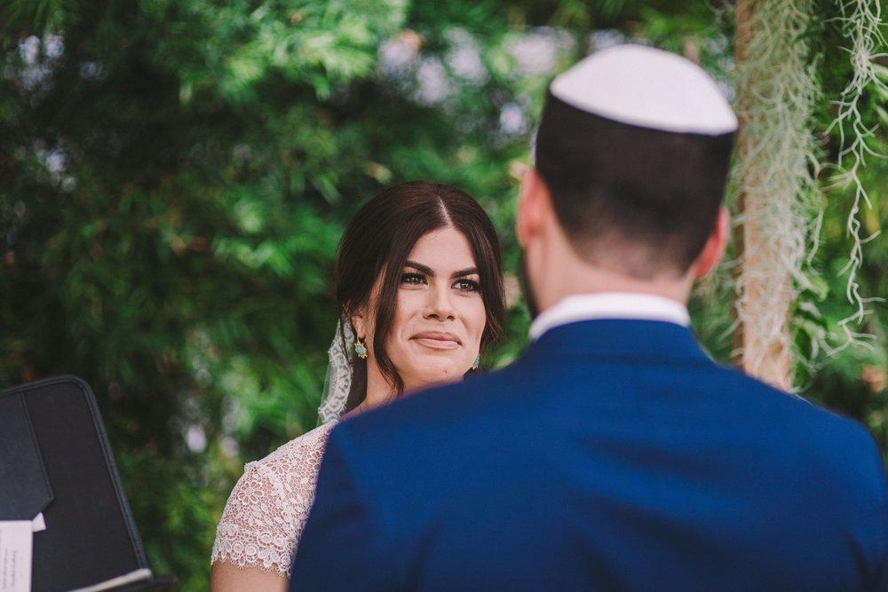Tearful Happy Bride at Modern Jewish Wedding in Shelldance Orchid Gardens