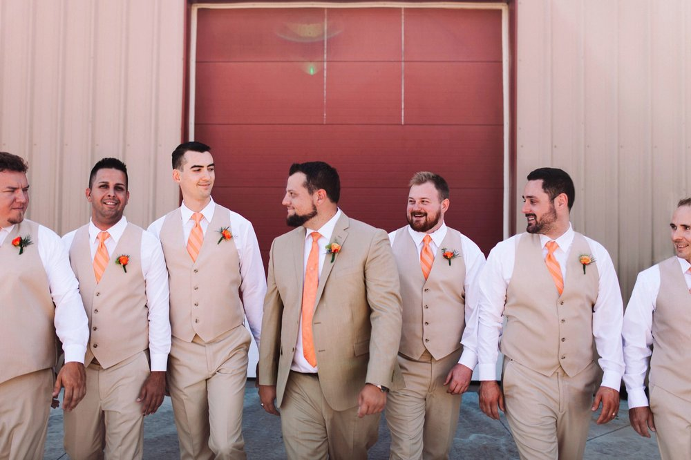 Orange Stripped Tie and Orange Boutonniere Groomsmen Wedding Outfit