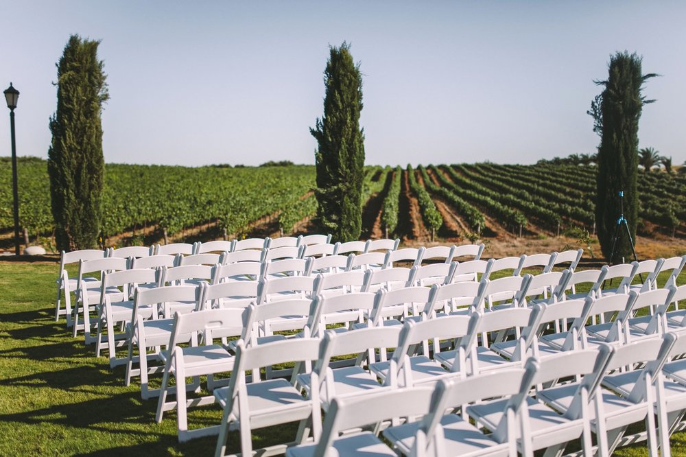 Toca Madera Winery Vineyard Outdoor Wedding Ceremony with White Chairs