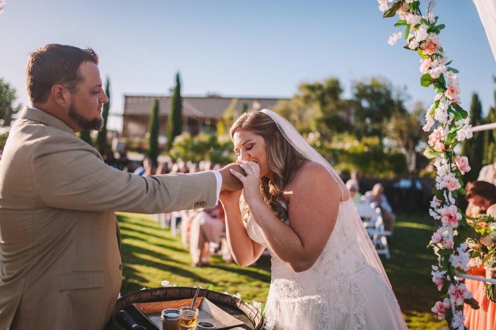 Bride & Groom Feeding Each Other Peanut Butter & Honey Sandwich During Wedding Unity Ceremony