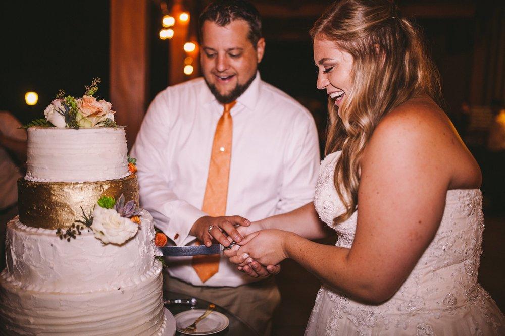 T-Cakes Fresno Wedding Cake Vendor - Bride & Groom Cutting Wedding Cake at Toca Madera Winery