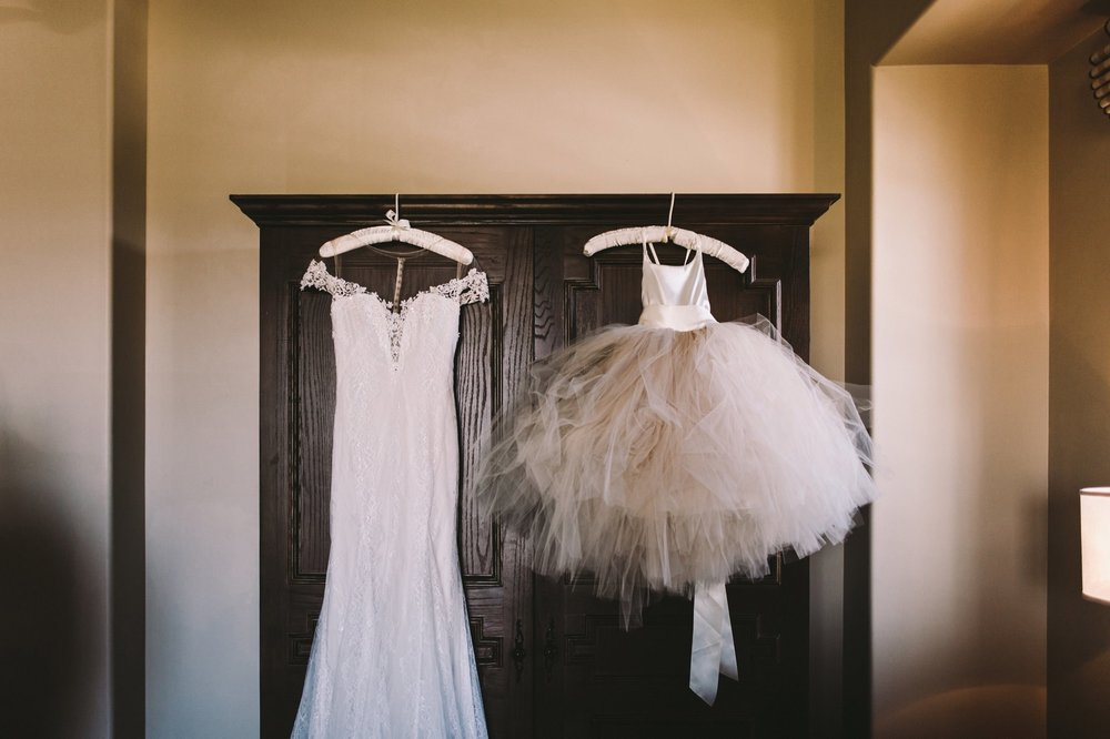 Maggie Sorreto Shae Wedding Dress & Flower Girl Dress Hanging