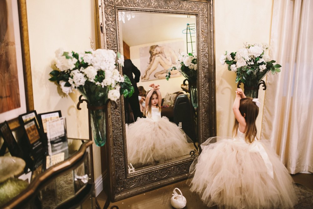 Flower Girl Looking in Mirror Wedding Photography